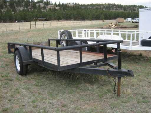2000 Texas Bragg texas bragg 12' tilt deck steel trailer