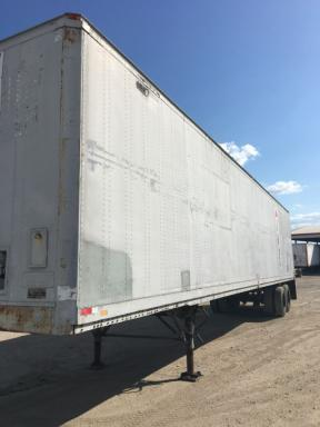 1985 Fruehauf 48x102-spring ride-swing door-alum roof